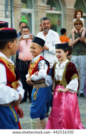 "Montenegro, Herceg Novi - 28/05/2016:  Children in national costumes Montenegro of the group ""Igalo"". 3 International Folklore Festival ""Meeting of the summer"""