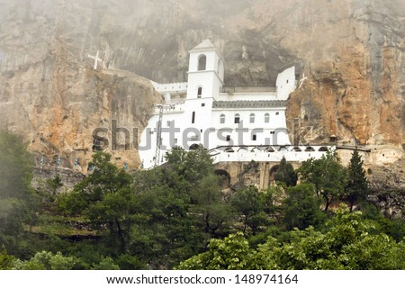 Montenegro mountain monastery. Serbian Orthodox Christian church in monastery Ostrog  - stock photo