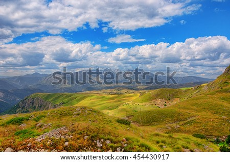 Montenegro, national park Durmitor, mountains and clouds panorama. Sunlight lanscape. Nature travel background.