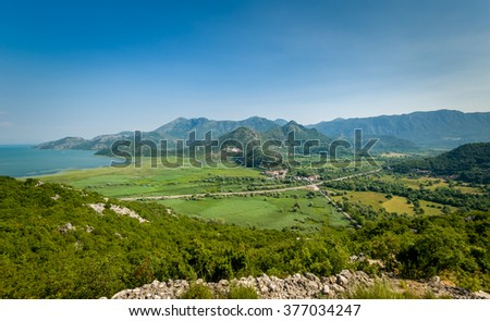 Montenegro summer landscape with Virpazar town - popular touristic resort on Skadar lake national park. Aerial view from the old mountain road.