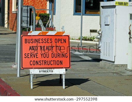 MONTEREY, CA - NOVEMBER 14:  Business Open During Construction Sign  2012 - stock photo
