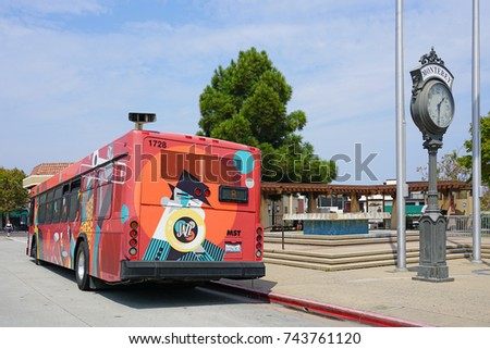 MONTEREY, CA -4 SEP 2017- A red bus from Monterey-Salinas Transit (MST) in Monterey, California.