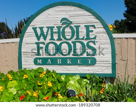 MONTEREY, CA/USA - APRIL 10, 2014:  Whole Food Market exterior sign.  Whole Foods is an American foods supermarket chain specializing in natural and organic foods. - stock photo