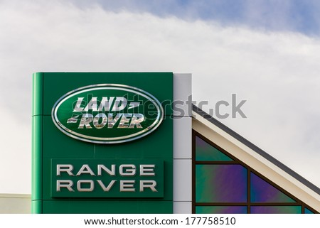 MONTEREY, CA/USA - FEBRUARY 17, 2014: Range Rover automobile dealership sign. Range Rover is a brand of Jaguar, a British multinational car manufacturer headquartered in Whitley, Coventry, England, - stock photo