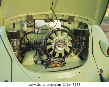 MONTEREY CAR WEEK August 16, 2015: Close up of Engine of Green 1st Generation Volkswagen Beetle from the 50s. - stock photo