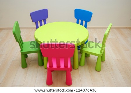 Montessori Kindergarten Preschool Classroom with table and chairs