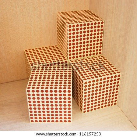 Montessori material - one thousand cube on wood background