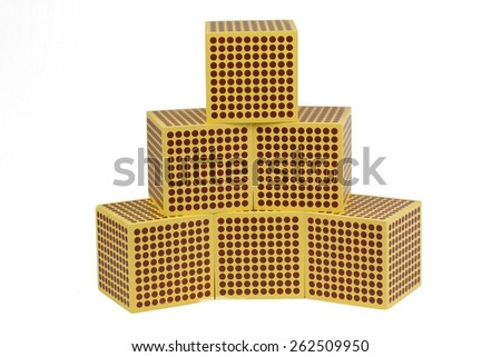 Montessori Materials.   Golden Bead 1000 Cube. - stock photo