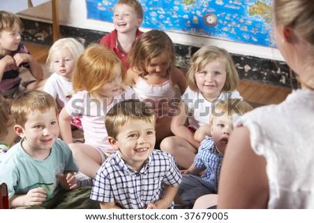 Montessori/Pre-School Class Listening to Teacher on Carpet - stock photo