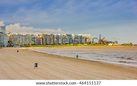 MONTEVIDEO, URUGUAY - MAY 04, 2016: nice view of the becah with some buildings in the background located in Avenida la Rambla.