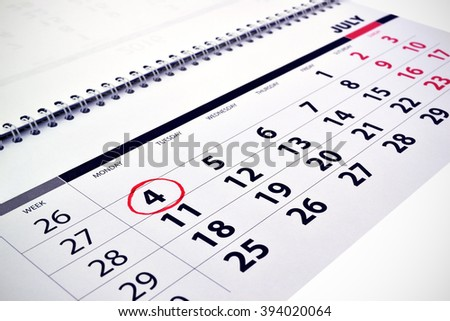 Monthly calendar with dates and  designation 4 July