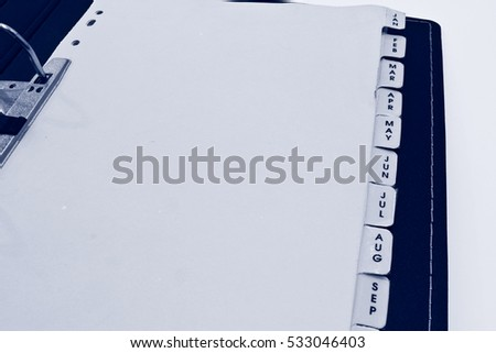 Monthly Filing Sheets in the Ring Binder Isolated on the White Background