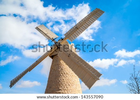 Montifiori windmill in Yemin Moshe, Jerusalem on background of blue sky - stock photo
