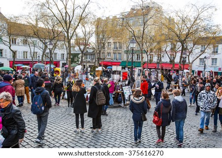 MONTMARTRE ,FRANCE - FEBRUARY 07, 2016: Place du Tertre in Montmartre, Paris with street artists and paintings