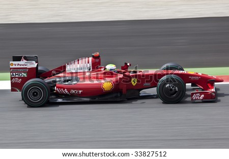 MONTMELO, SPAIN - MAY 10: Ferrari participates in the Spanish Grand Prix on May 10, 2009 in Montmelo, Spain.  Felipe Massa finished in 6th place and Kimi Raikkonen did not finish. - stock photo