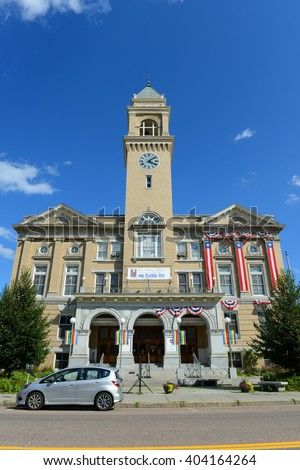 MONTPELIER, VT, USA - AUG 11:  Montpelier City Hall is located at the bank of Winooski River on Aug. 11, 2013 in downtown Montpelier, Vermont, USA.  - stock photo