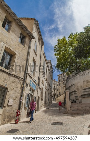 MONTPELLIER, FRANCE - JULY 13, 2015: Unidentified people on the street of  Montpellier, France. Montpellier is the 8th largest city IN France, and fastest growing city in the country