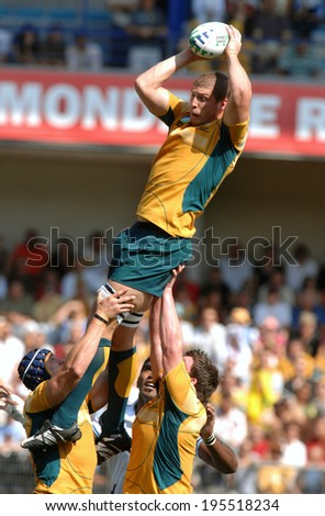 MONTPELLIER, FRANCE-SEPTEMBER 23, 2007: australian rugby player, Daniel Vickerman, catches the ball in touche during the match Australia vs Fiji, at the Rugby World Cup, France 2007, in Montpellier. - stock photo