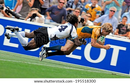 MONTPELLIER, FRANCE-SEPTEMBER 23, 2007: australian rugby player, Drew Mitchell, scores a try during the match Australia vs Fiji, at the Rugby World Cup, France 2007, in Montpellier. - stock photo