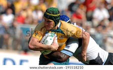 MONTPELLIER, FRANCE-SEPTEMBER 23, 2007: australian rugby player, Matt Giteu, runs with the ball during the match Australia vs Fiji, at the Rugby World Cup, France 2007, in Montpellier.