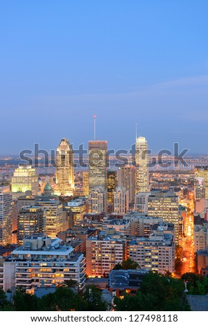 Montreal at dusk with urban skyscrapers viewed from Mont Royal - stock photo