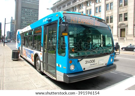 MONTREAL - AUG 4: Montreal Express Bus #747 on Aug 4, 2011 in downtown Montreal, Quebec, Canada. - stock photo