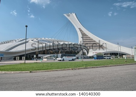 MONTREAL - AUG 13: The tower of the Montreal Olympic Stadium on August 13, 2009 in Montreal. It's the tallest inclined tower in the world.Tour Olympique stands 175 meters tall and at a 45-degree angle - stock photo