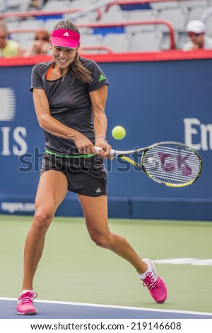 MONTREAL - AUGUST 3: Ana Ivanovic of Serbia at a practice session at the 2014 Rogers Cup on August 3, 2014 in Montreal, Canada - stock photo
