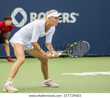 MONTREAL - AUGUST 7: Caroline Wozniacki of Denmark in her third round match win over Shelby Rogers of USA at the 2014 Rogers Cup on August 7, 2014 in Montreal, Canada