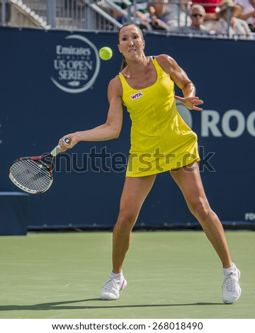 MONTREAL - AUGUST 6: Jelena Jankovic of Serbia in her Second round match win over Sloane Stephens of USA at the 2014 Rogers Cup on August 6, 2014 in Montreal, Canada