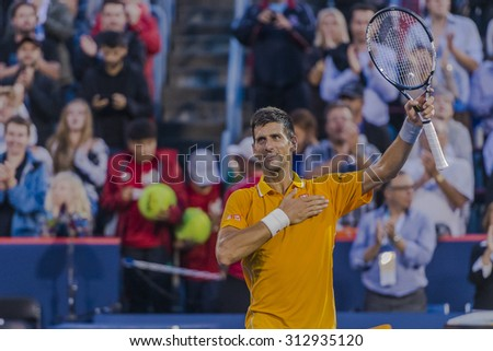 MONTREAL - AUGUST 11: Novak Djokovic of Serbia greats the fans after his second round match win over Thomaz Bellucci of Brazil  at the 2015 Rogers Cup on August 11, 2015 in Montreal, Canada  - stock photo