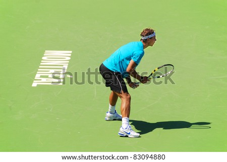 """MONTREAL - AUGUST 5:Raphael Nadal on training court at Montreal Rogers Cup on August 5, 2011 in Montreal, Canada. Rafael """"Rafa"""" Nada is a Spanish professional tennis player and a former World No. 1. - stock photo"""
