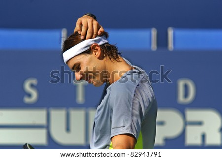 """MONTREAL - AUGUST 5:Raphael Nadal on training court of Montreal Rogers Cup on August 5, 2011 in Montreal, Canada. Rafael """"Rafa"""" Nada is a Spanish professional tennis player and a former World No. 1. - stock photo"""