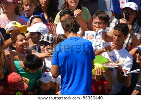 """MONTREAL - AUGUST 5:Raphael Nadal with fans of Montreal Rogers Cup on August 5, 2011 in Montreal, Canada. Rafael """"Rafa"""" Nada is a Spanish professional tennis player and a former World No. 1. - stock photo"""