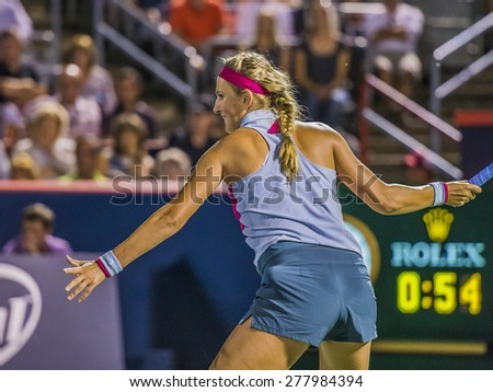 MONTREAL - AUGUST 8: Victoria Azarenka of Belarus in her Quarter Final match loss to Agnieszka Radwanska of Poland at the 2014 Rogers Cup on August 8, 2014 in Montreal, Canada