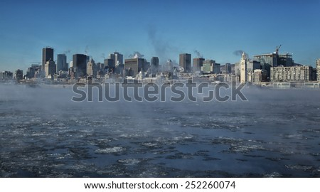 Montreal by a very cold day.  St-Lawrence river with steam on it with downtown Montreal in background in Quebec province in Canada - stock photo