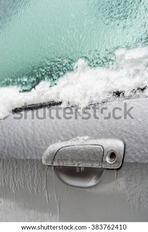 Montreal, CA, 29th February 2016. Car handle is covered with ice after icy rain. - stock photo