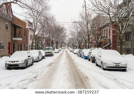 Montreal, CA, 7th March 2016. Laval Street during snow storm