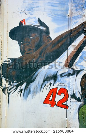 MONTREAL CANADA AUG. 30:Street art Montreal Jackie Robinson on august 30 2014 in Montreal Canada. Montreal. is the perfect place to walk in the back alleys and abandoned areas, looking for street art - stock photo