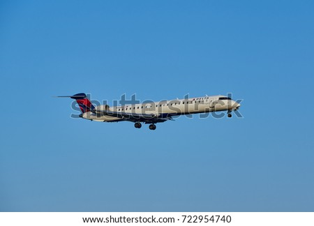 MONTREAL, CANADA - AUGUST 28, 2017 : Landing Delta Connection Bombardier INC CL-600 airplane. Delta Connection is a regional airline brand name for Delta Air Lines