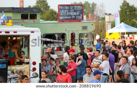 MONTREAL, CANADA - AUGUST 01: More than 40 food trucs on the esplanade Financiere Sun Life for the event  first friday of the month on august 01 in Montreal, Canada.  - stock photo