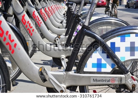 MONTREAL, CANADA - 16 AUGUST 2015 - Shared bikes are lined up in the streets of Montreal, Quebec. BIXI Montreal, launched in May 2009, has over 400 stations and 5000 bikes.
