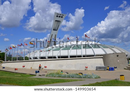 MONTREAL,CANADA - AUGUST 11.The Montreal Olympic Stadium and tower on August 11, 2013. It's the tallest inclined tower in the world.Tour Olympique stands 175 meters tall and at a 45-degree angle - stock photo