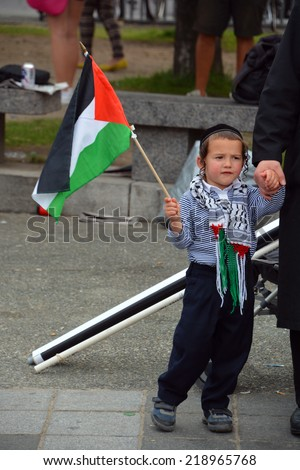 MONTREAL CANADA AUGUST 21:Unidentified kid from jewish Hasidic Orthodox Judaism, participating in a rally to condemn the Israel occupation an bombing on Gaza On 08 21 2014 in Montreal Quebec Canada - stock photo