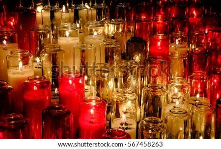 alter lighting. montreal canada circa october 2016 colourful red candled alter candles in there jars lighting