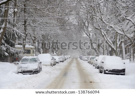 MONTREAL-CANADA DEC. 27:Cars cover of snow on Melrose Street. The snow storm slam Montreal with 45 cm of snow, Canada on December 27, 2012 after knocking out power to thousands of homes in the U.S. - stock photo