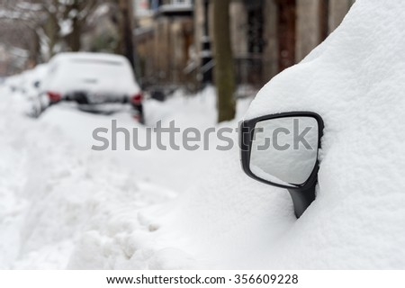 Montreal, Canada - 30 December 2015. Cars covered with snow after first snow storm of the season. - stock photo