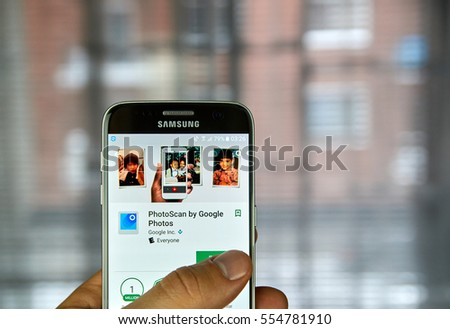 MONTREAL, CANADA - DECEMBER 23, 2016 : PhotoScan is a new scanner app from Google Photos that lets users scan and save their favorite printed photos using phone s camera.