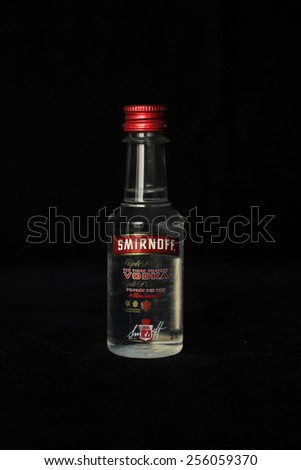 MONTREAL, CANADA - FEBRUARY 11, 2015:  Bottle of Smirnoff vodka on a black background. - stock photo