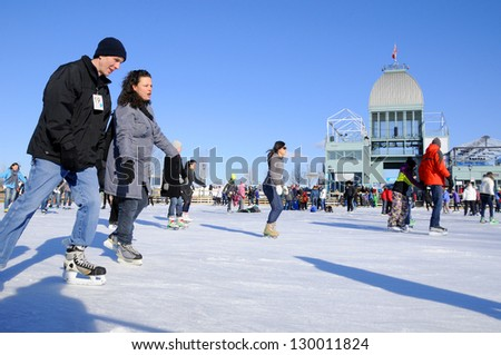 MONTREAL CANADA FEBRUARY 25: Old port ice ring artificial surface of ice, incredible views of historic Old-Montreal and the river on February 25 2012 in Montreal Quebec, Canada - stock photo